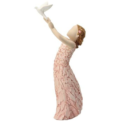 More the Words girl in pink dress with dove of peace figurine